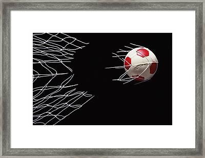 Soccer Ball Breaking Through Goal Net Framed Print