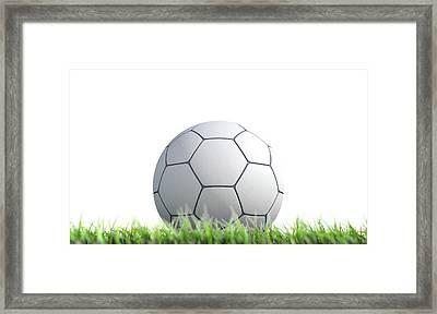Soccer Ball Resting On Grass Framed Print by Allan Swart