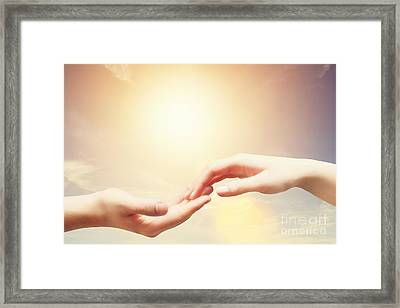 Soft And Gentle Touch Of Man And Woman Against Sunny Sky With Flare In Vintage Mood Framed Print by Michal Bednarek