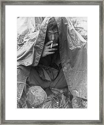 Soggy Soldier In Vietnam Framed Print by Underwood Archives