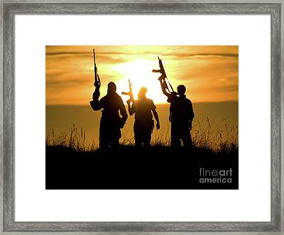 Soldiers Against A Sunset Framed Print by Oleg Zabielin