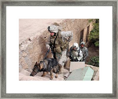 Soldiers Move To The Roof Of A Metal Framed Print by Stocktrek Images