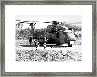 Soldiers Run To A Hh-53c Helicopter Framed Print by Stocktrek Images