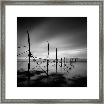 Solway Firth Fishing Nets Framed Print by Dave Bowman