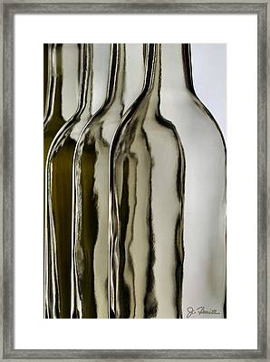 Somber Bottles Framed Print by Joe Bonita