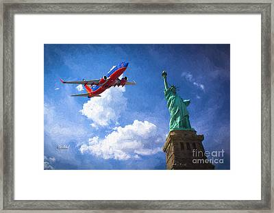 Southwest Over The Statue Of Liberty Framed Print by Garland Johnson