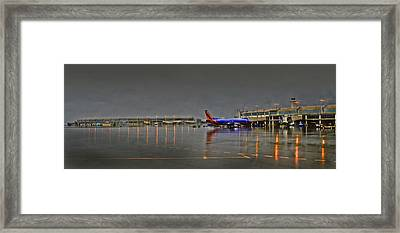 Southwest Plane In The Rain Framed Print