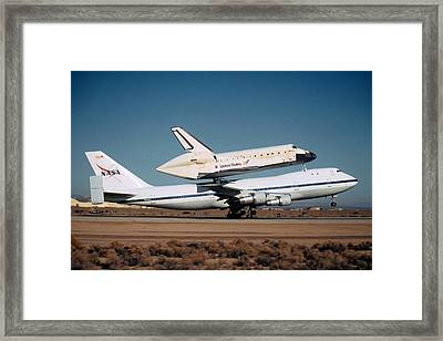 Space Shuttle Discovery Departs Edwards Afb November 2 2000  Framed Print by Brian Lockett
