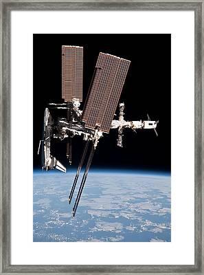 Space Shuttle Endeavor Docked Framed Print by Everett