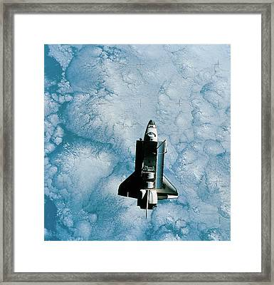 Space Shuttle Orbiting Above Earth Framed Print