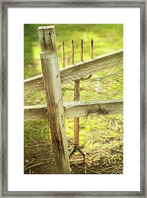 Spading Fork On Chicken Wire Fence Framed Print
