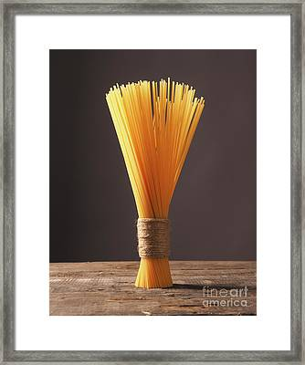 Spaghetti On A Wooden Table Framed Print by Andreas Berheide