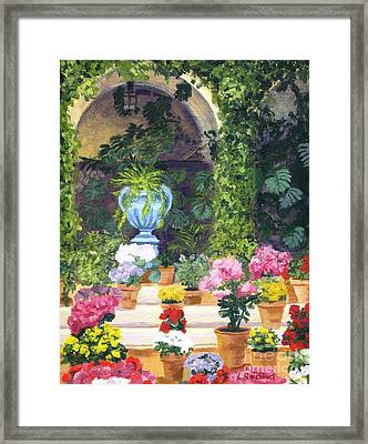 Spanish Courtyard Framed Print by Lynne Reichhart