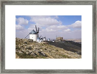 Spanish Windmills And Castle Of Consuegra Framed Print by Perry Van Munster