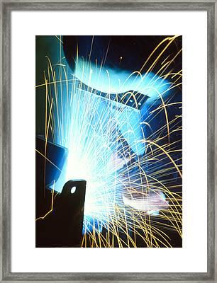 Sparks Flying From An Argon Welder At Work Framed Print