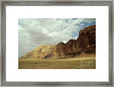 Sparse Tussock And Rock Formations In The Wadi Rum Desert Framed Print by Sami Sarkis