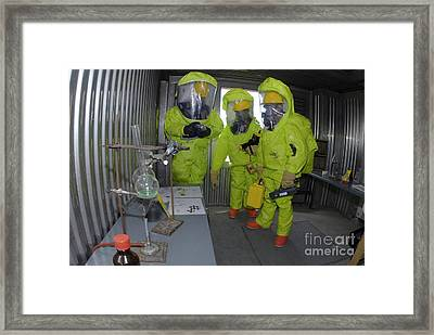 Specialists Survey A Simulated Area Framed Print by Stocktrek Images