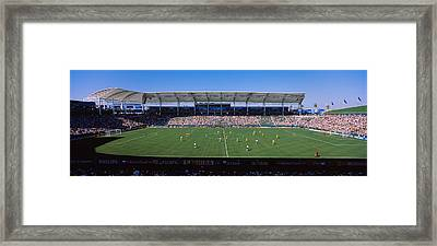 Spectators Watching A Soccer Match Framed Print by Panoramic Images
