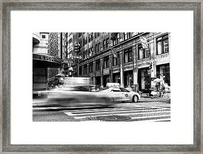 Speed In The City Framed Print by John Rizzuto
