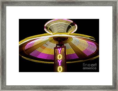 Spinning Yoyo Ride Framed Print by Juli Scalzi