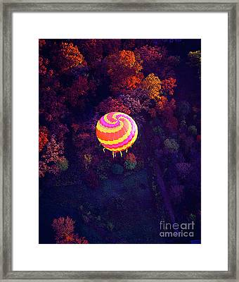 Spiral Colored Hot Air Balloon Over Fall Tree Tops Mchenry   Framed Print by Tom Jelen