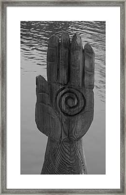 Spiral Hand On The Water Framed Print by Rob Hans