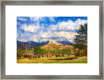 Castle Above The Village Framed Print