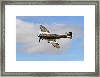 Spitfire Against The Clouds Framed Print