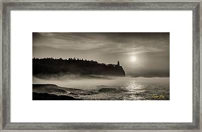 Split Rock Lighthouse Emerging Fog Framed Print by Rikk Flohr