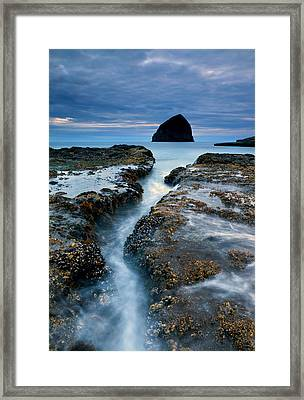 Splitting Stone Framed Print
