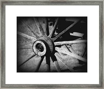 Spoked Wheel Framed Print by Perry Webster