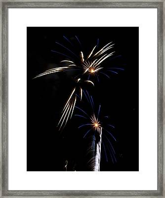 Spokes Of Light At Night Framed Print by Kevin Munro