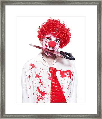 Spooky Clown Holding Bloody Saw In Mouth On White Framed Print