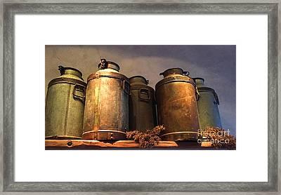 Spotlight On Old Milk Cans  Framed Print