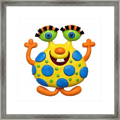 Spotted Yellow Monster Framed Print by Amy Vangsgard