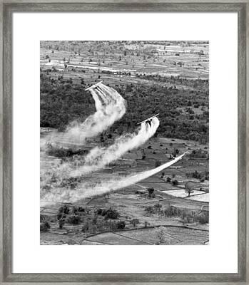 Spraying Agent Orange Framed Print by Underwood Archives
