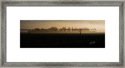 Sprinkler In The Fog Framed Print