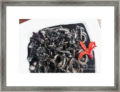 Squid In Ink Framed Print by Atiketta Sangasaeng