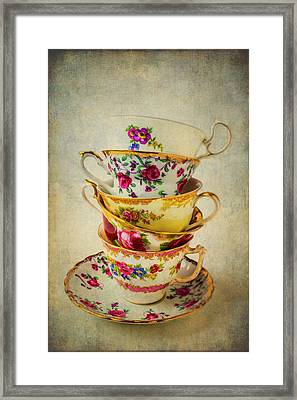 Stack Of Pretty Tea Cups Framed Print by Garry Gay
