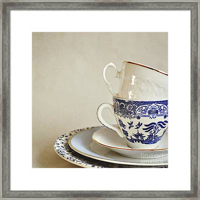 Stacked Blue And White China Cups And Saucers. Framed Print by Lyn Randle