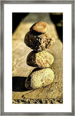 Framed Print featuring the photograph Stacked Rocks by Onyonet  Photo Studios