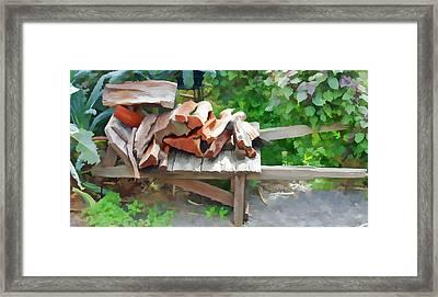 Stacking The Firewood Framed Print by Pamela Walton