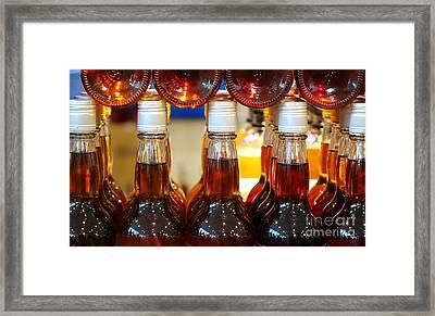Stacks Of Vinegar Bottles Framed Print by Yali Shi