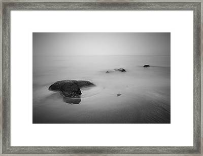 Staffin Bay Mist Framed Print by Grant Glendinning