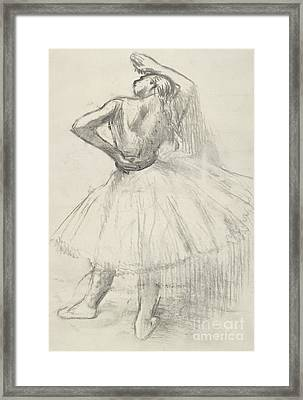 Standing Dancer, Right Arm Raised Framed Print by Edgar Degas