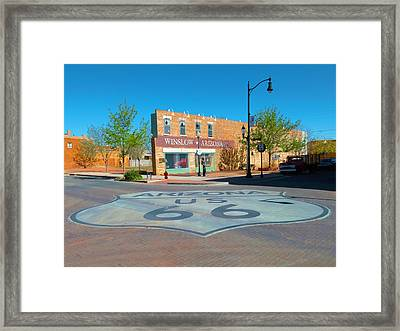 Standing On A Corner Framed Print