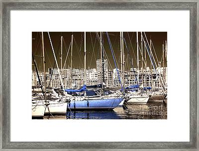 Standing Out In Marseille Framed Print by John Rizzuto