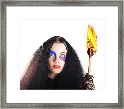 Staring Woman Holding Flame Torch Framed Print by Jorgo Photography - Wall Art Gallery