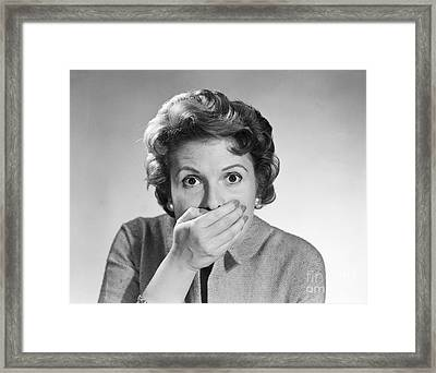 Startled Woman Covering Mouth, C.1950s Framed Print by Debrocke/ClassicStock
