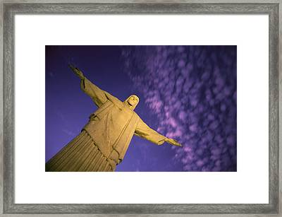 Statue Of Jesus Christ Against Twilight Framed Print by Michael Melford